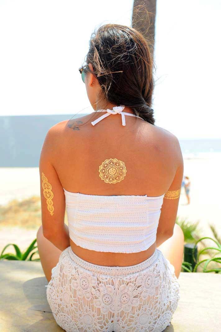[:es]Tatuajes metálicos hay de todas formas y estilos, pero los étnicos y orientales son los que más triunfan. FOTOS GABRIEL VÁZQUEZ[:]